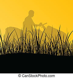 Man with lawn mower tractor cutting grass in field landscape...