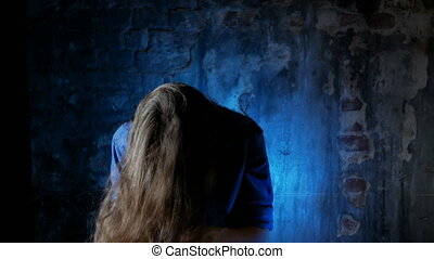 man with long hair shaking his head while in the apartment