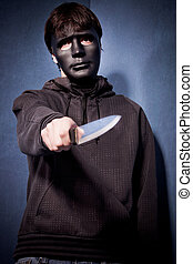 man with mask and knife