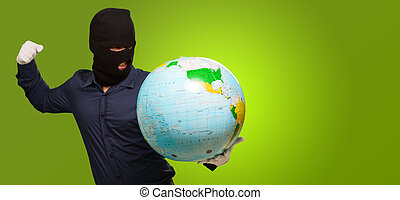 man with mask holding a globe