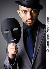 Man with mask in the dark
