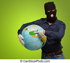 man with mask pointing at globe