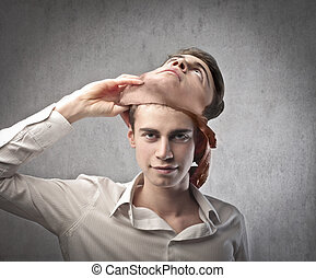 man with mask - young man removes his mask