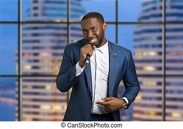 Man with microphone on urban background.
