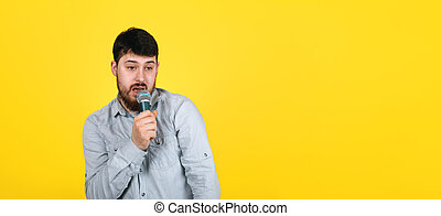 man with microphone panoramic
