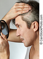 Man with mirror looking at his hair