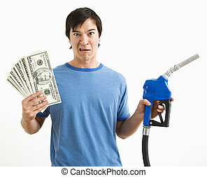 Man with money and gas nozzle.