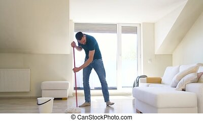 man with mop cleaning floor at home - people, housework and...