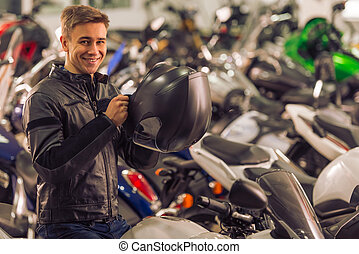 Man with motorbike - Attractive young blond man in black...