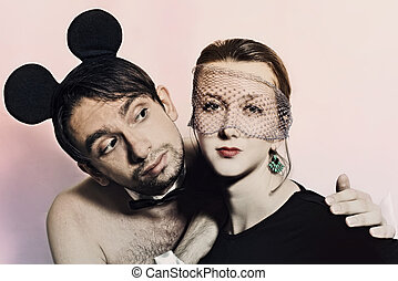 man with mouse ears and a woman in a veil