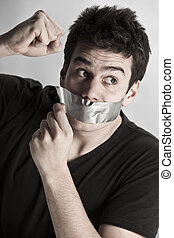 Man with mouth covered by masking tape preventing speech.