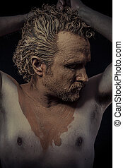 man with mud all over his body, naked, conceptual art