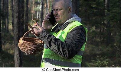 Man with mushroom and basket