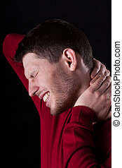 Man with neck ache on isolated background