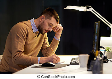 man with notepad working at night office