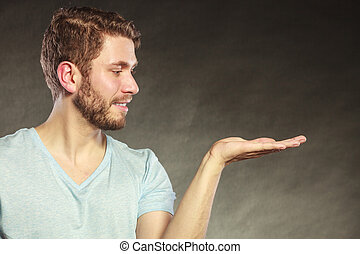 Man with open empty hand palm for copy space.