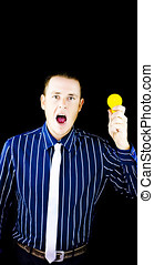 Man with open mouth holding yellow bulb