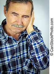 Man with pain in the ear