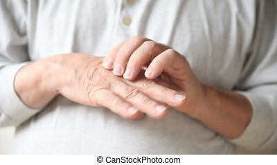man with painful finger joints - a man experiences pain in...
