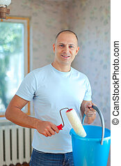 man with paint roller