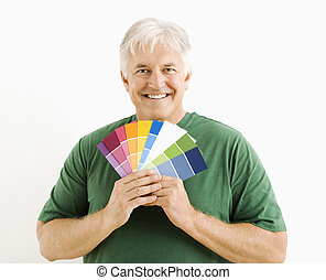 Man with paint swatches.