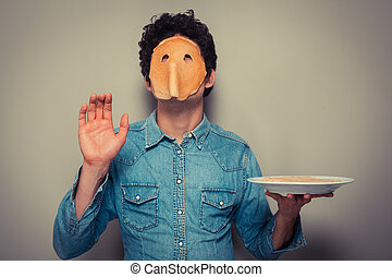 Man with pancake on his face