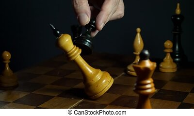 Man with pawn wins in chess game. Falling king on vintage...