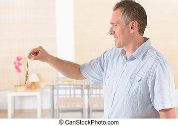 Man with pendulum
