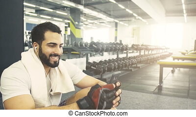 Man with Phone in the Gym