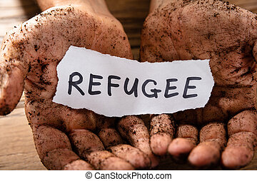 Man With Piece Of Paper Showing Refugee Word