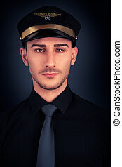 Man with Pilot Hat and Black Shirt - Young man wearing...