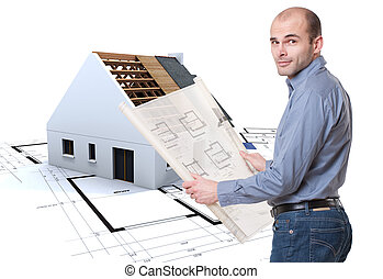 Man with plans and house in construction