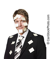 Man with postitnotes all over his face