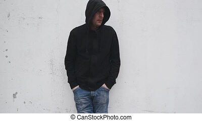 Man with problems. Man in hood.