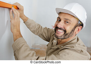 man with professional level tool