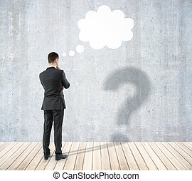 Man with question and thought cloud