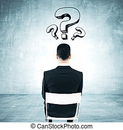 Man with question marks