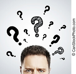 man with questions symbol over head