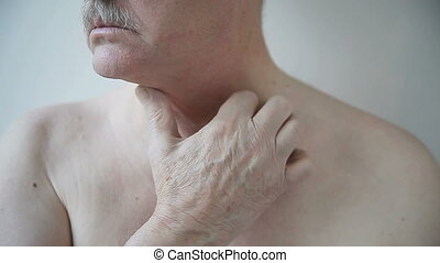 man with rash on neck - shirtless man scratches his ...