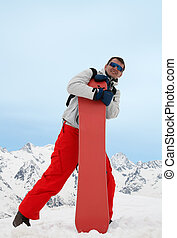 Man with red snowboard