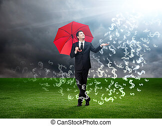 Man with red umbrella and currency signs falling from the sky