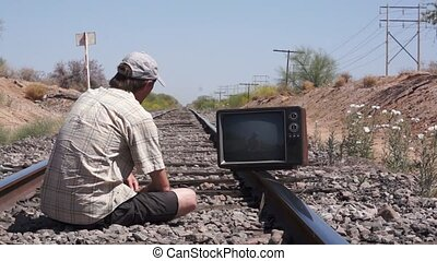 Man with Retro TV on Traintracks - Man trespassing and...