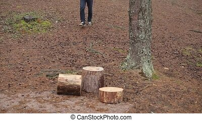 Man with round log at cloudy day