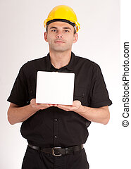 Man with safety helmet holding a white box