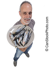 man with sardine on white background