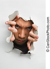 Man with scary look from cracked wall
