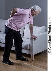 Man with sciatica - Retired man with sciatica spasm