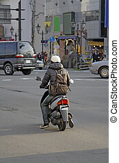 Man with scooter
