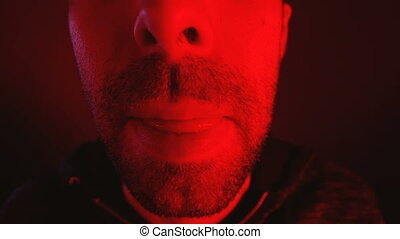 Man with seductive facial expression sticking out his tongue...