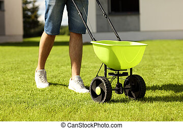 Man with seeder